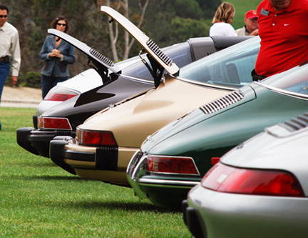 line-of-porsches-back-hoods-open-8511360